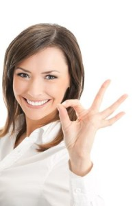 Portrait of happy smiling businesswoman with okay gesture